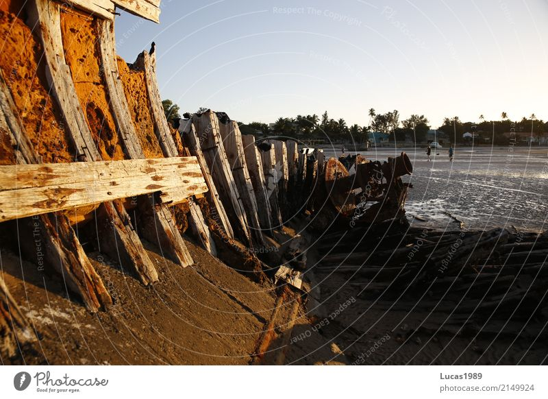 shipwreck at low tide Sand Water Beautiful weather Waves Coast Beach Ocean Island Mozambique Village Fishing village Port City Harbour Transport Navigation