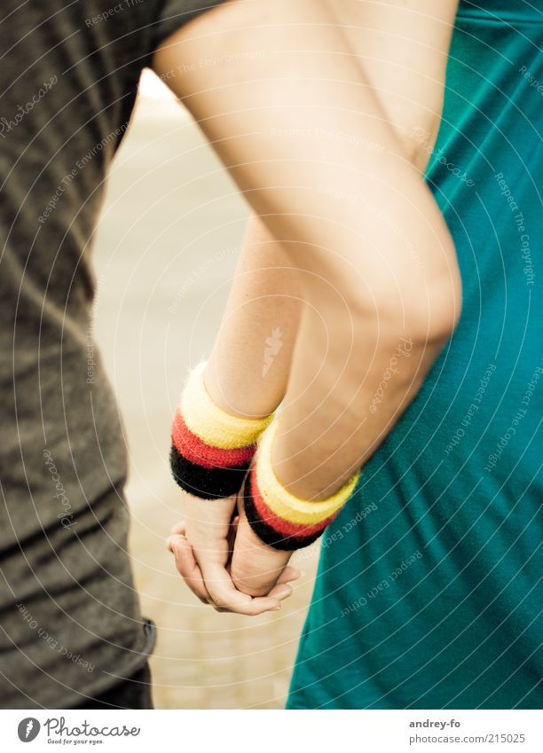 hand in hand Arm Hand 2 Human being sweatband Touch Embrace Friendliness Together Yellow Red Black Emotions Trust Love Friendship Idyll German Flag Bracelet