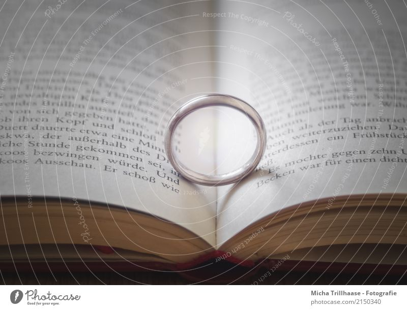 Marriage & Relationship Book Reading Accessory Jewellery Ring Wedding band Sign Glittering Love Argument Near Yellow Violet Orange Red White Emotions Happy