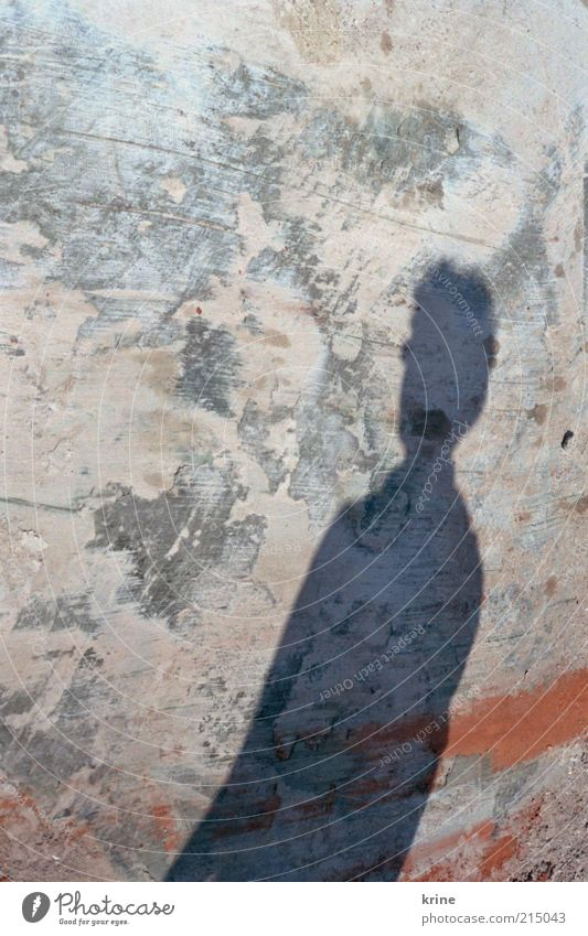 shadow Masculine 1 Human being Wall (barrier) Wall (building) Facade Short-haired Stone Concrete Stand Wait Loneliness Expectation Uniqueness Colour