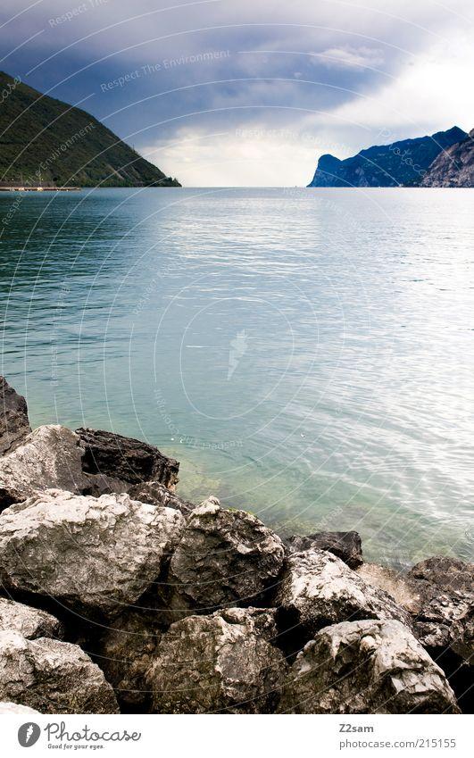 Nature Water Beautiful Sky Summer Calm Clouds Far-off places Dark Mountain Stone Lake Landscape Environment Esthetic Romance