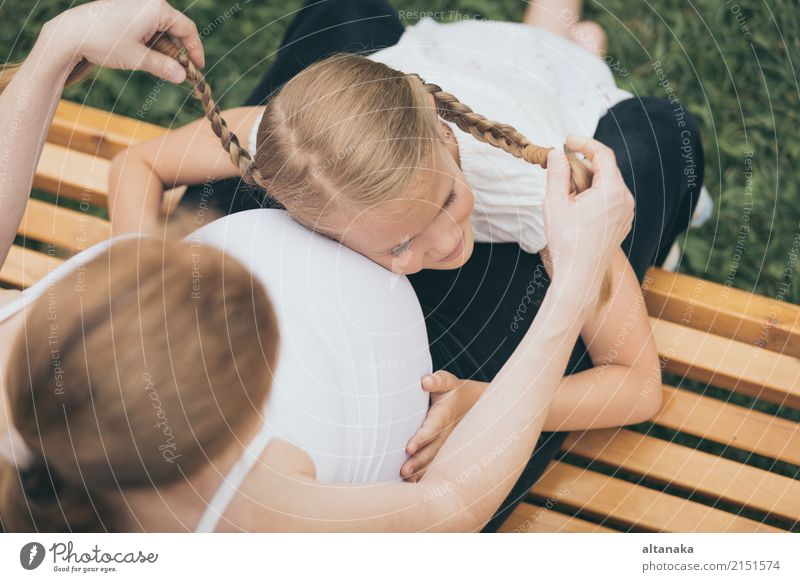 Happy little girl hugging mother in the park at the day time. Child Woman Nature Vacation & Travel Summer Joy Adults Lifestyle Love Sports Boy (child)
