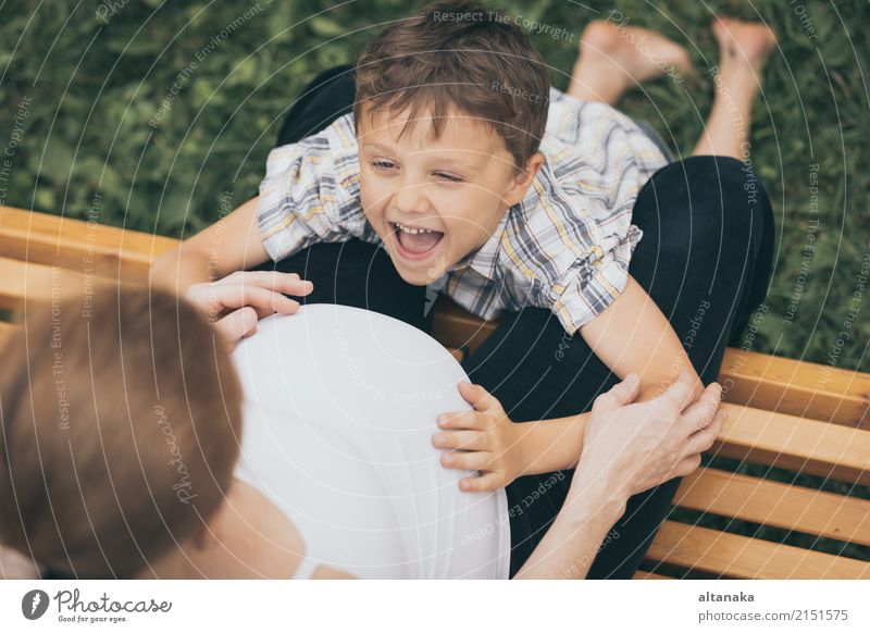 Happy little boy hugging mother in the park at the day time. Child Woman Nature Vacation & Travel Summer Joy Adults Lifestyle Love Sports Boy (child)
