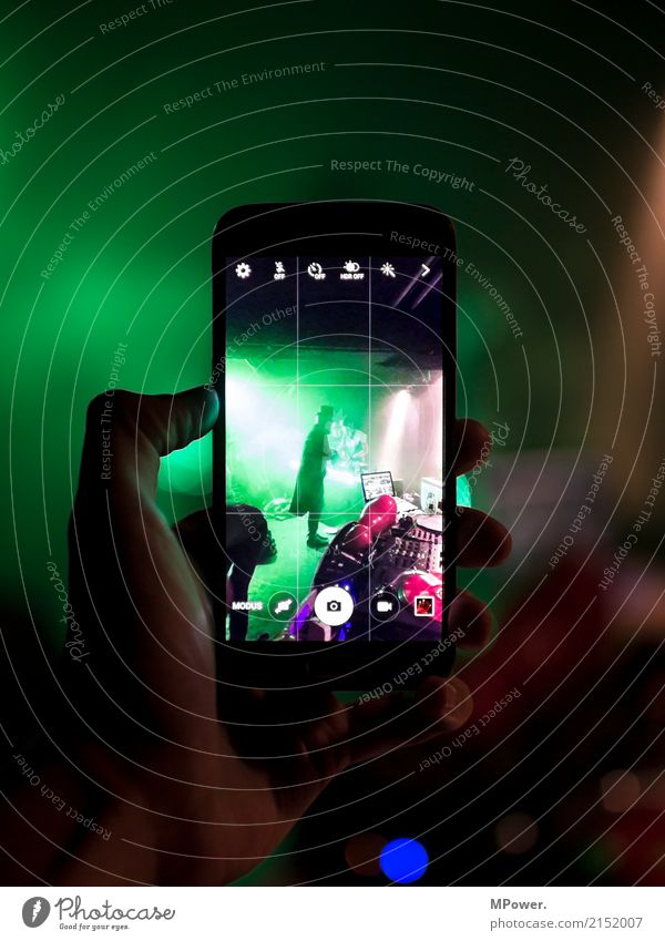 Human being Green Hand Party Feasts & Celebrations Fog Music Crazy Photography Youth culture Shows Cellphone Media Event Camera Concert