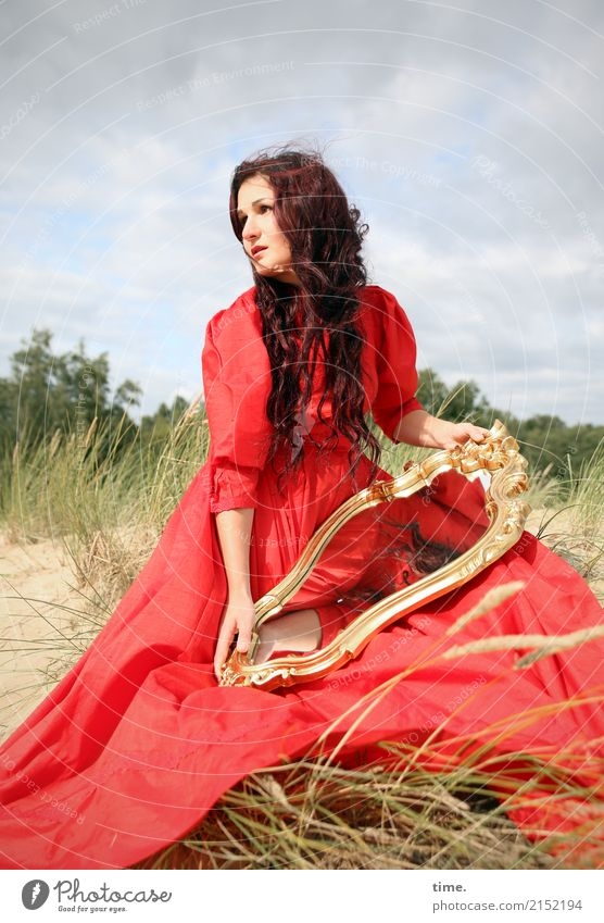 . Feminine Woman Adults 1 Human being Sky Summer Beautiful weather Hill Coast Dune Marram grass Dress Brunette Long-haired Curl Part Mirror Observe To hold on