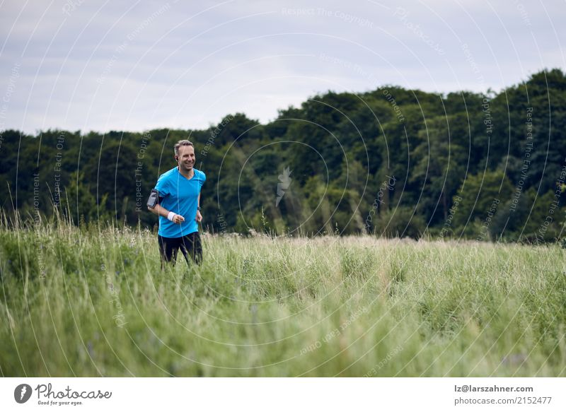 Fit muscular man jogging on a rural trail Lifestyle Summer Sports Jogging Man Adults 1 Human being 30 - 45 years Nature Landscape Autumn Lanes & trails Fitness