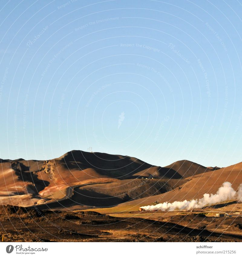 Landscape Earth Esthetic Beautiful weather Hill Cloudless sky Smoke Dusk Iceland Volcano Steam Natural phenomenon Country road Force of nature Experiencing nature Geothermy