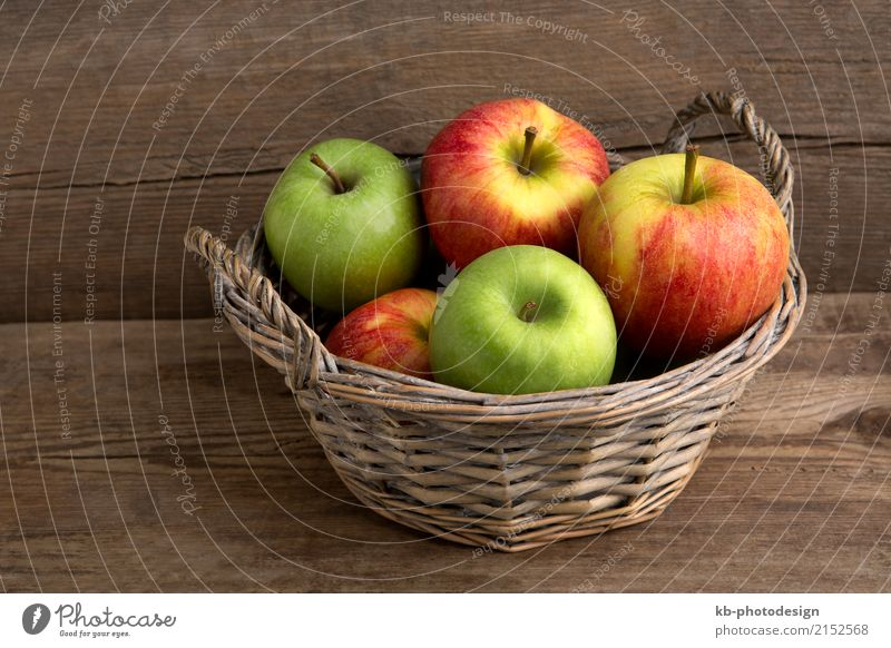 Basket of fresh apples on a wooden background Food Fruit Apple Organic produce Vegetarian diet Diet Fasting Eating fruit basket freshness eat friuts vegetarian