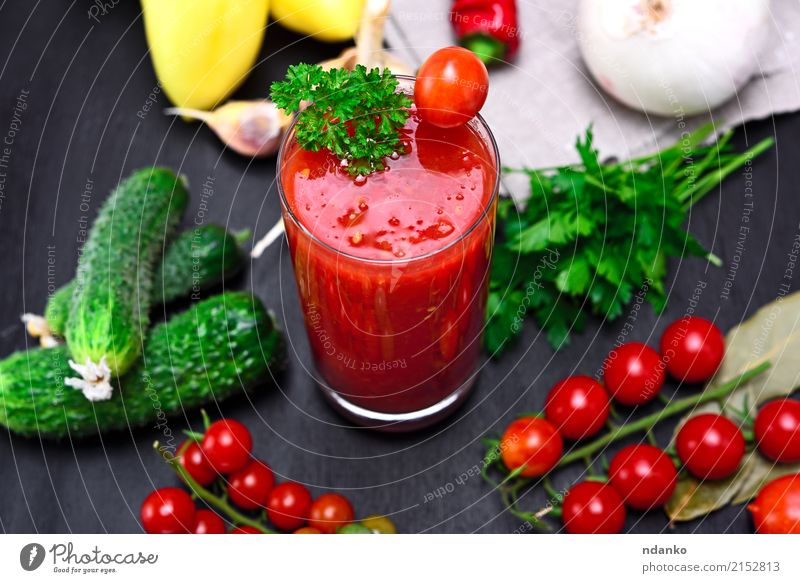 glass of freshly squeezed tomato juice Vegetable Herbs and spices Vegetarian diet Diet Cold drink Juice Glass Kitchen Wood Fresh Above Green Red Black Tomato