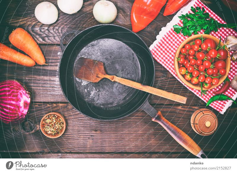 Empty black frying pan Old Red Black Dish Wood Metal Fresh Table Herbs and spices Kitchen Vegetable Meal Top Cooking Tomato Spoon