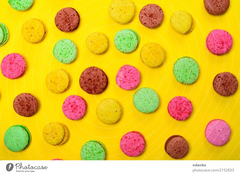 Colorful pastry macarons Food Dessert Candy Gastronomy Eating Bright Brown Multicoloured Yellow Green Pink Tradition colorful background Macaron sweet cake