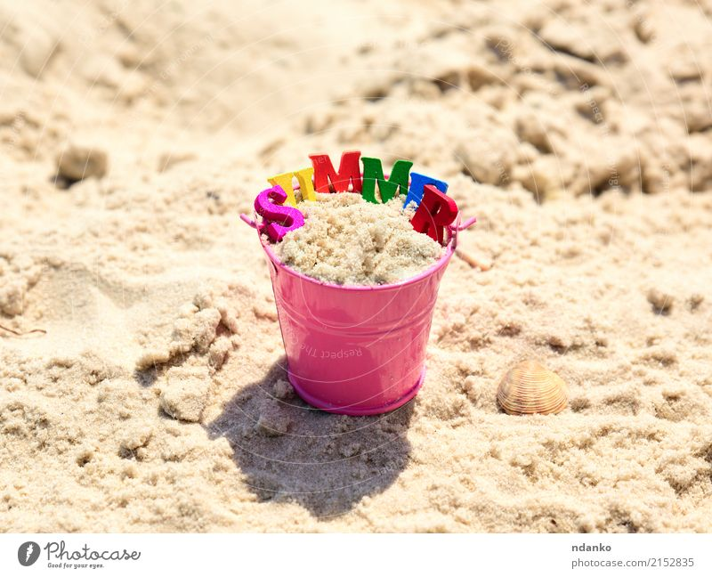Pink baby bucket with sand Joy Relaxation Playing Vacation & Travel Trip Summer Sun Beach Ocean Child Nature Sand Coast Toys Wood Blue Yellow Conceptual design