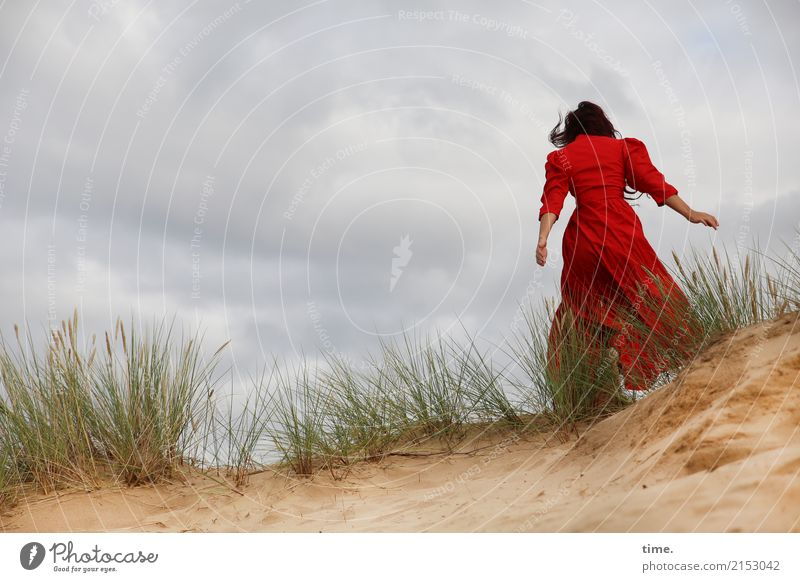 . Feminine Woman Adults 1 Human being Sand Clouds Storm clouds Wind Gale Dune Marram grass Dress Brunette Long-haired Movement Walking Red Emotions