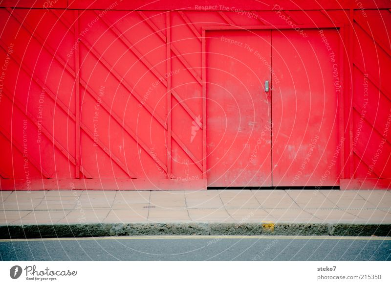 red door Door Discover Bans Hiding place Construction site Barrier Red Wooden wall Colour photo Exterior shot Deserted Copy Space left Copy Space bottom