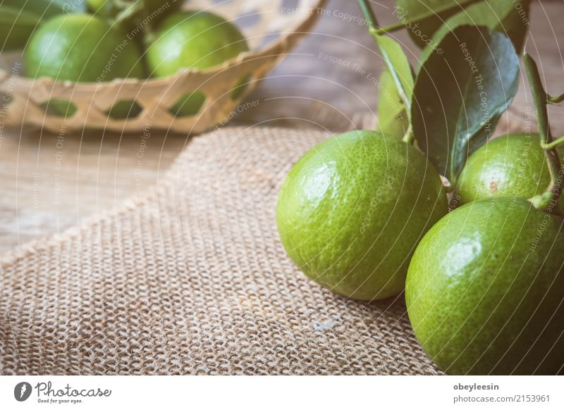 Backgrounds. Close up shot of wet limes Fruit Vegetarian diet Lemonade Group Fresh Juicy Sour Green White ripe isolated Half Part Slice two background Sliced
