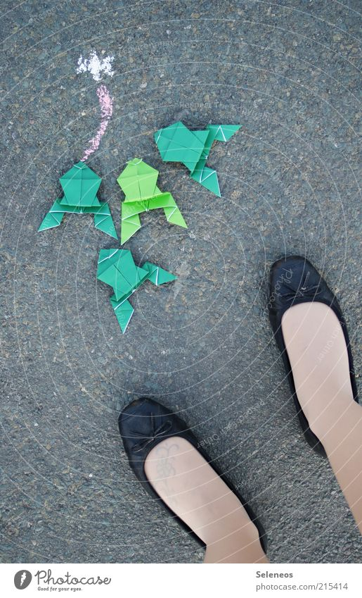 Human being Animal Street Feminine Playing Legs Small Feet Footwear Leisure and hobbies Paper Stand Asphalt Frog Chalk Tongue