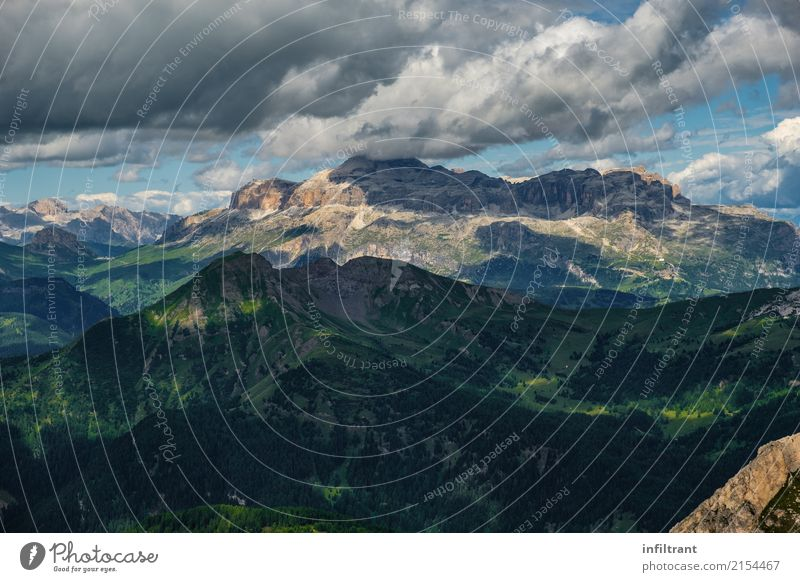 Mountain range in the Dolomites Adventure Far-off places Freedom Summer Hiking Nature Landscape Clouds Rock Alps Peak Vacation & Travel Threat Gigantic Infinity