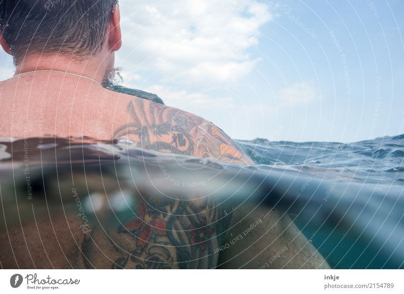 The man and the sea, cuddling. Lifestyle Style Harmonious Senses Relaxation Swimming & Bathing Leisure and hobbies Summer Summer vacation Ocean Waves Masculine