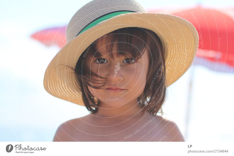 Girl with a straw hat Lifestyle Luxury Elegant Style Beautiful Parenting Education Human being Feminine Child Baby Parents Adults Brothers and sisters