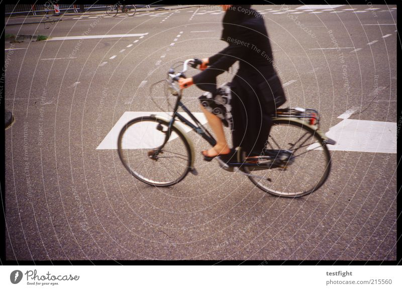 just drive Cycling Human being Legs 1 Means of transport Traffic infrastructure Crossroads Skirt Coat Movement Esthetic Beautiful Town Lane markings