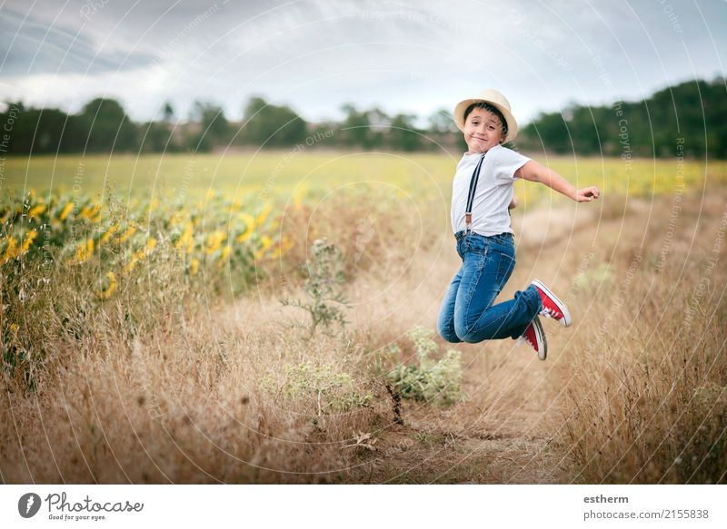 Smiling boy jumping in the field Human being Child Nature Vacation & Travel Summer Landscape Joy Lifestyle Meadow Boy (child) Laughter Playing Freedom
