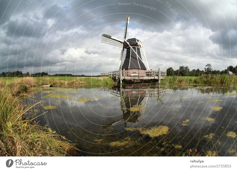 windmill reflected in lake water on sunny day Summer Sun Culture Landscape Sky Clouds Meadow Pond Lake Building Architecture Blue Green Windmill star sunshine