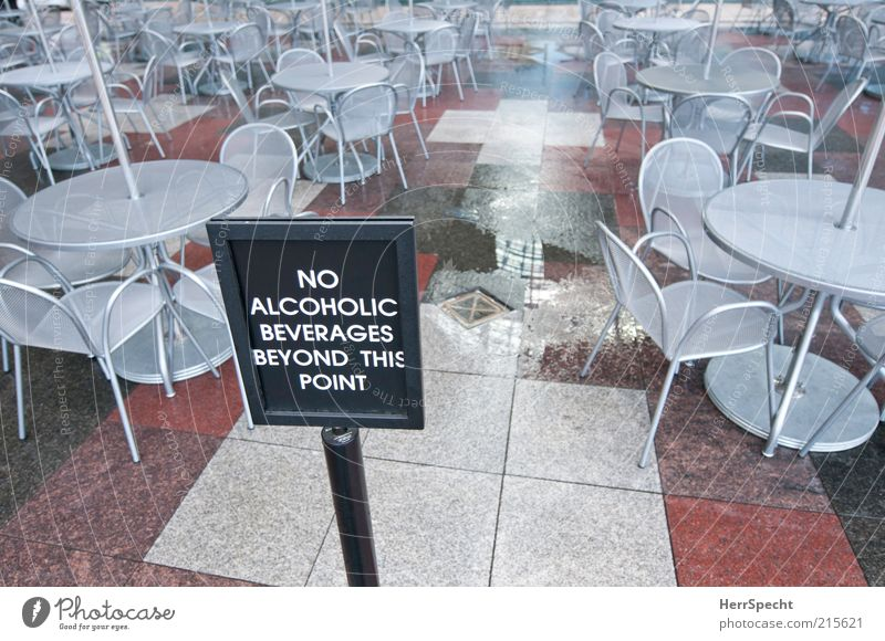 non-drinker zone Alcoholic drinks Chair Table Restaurant Wet Gloomy Gray Red Café Sidewalk café Prohibition sign Bans Closed Water puddle Puddle Colour photo