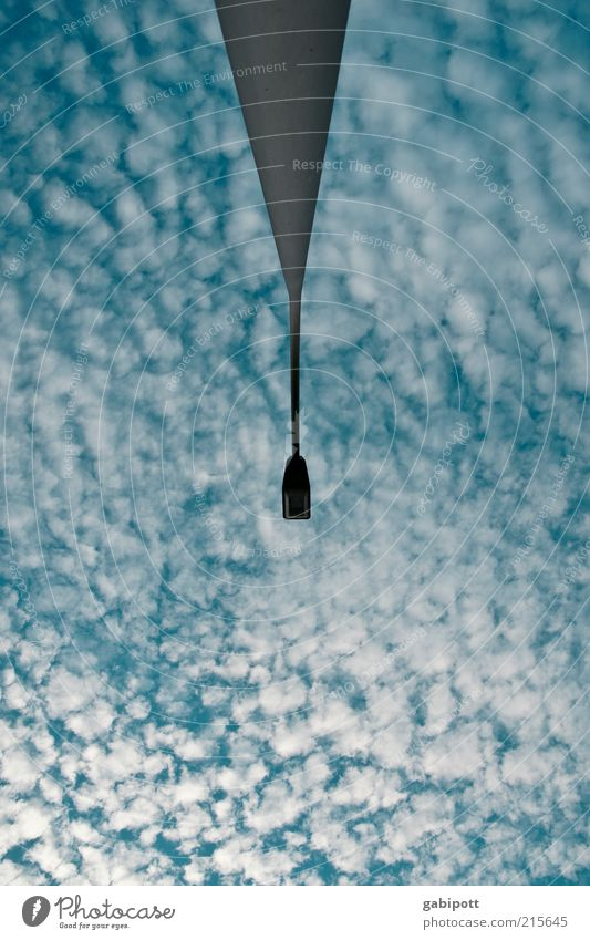 Cloudy Environment Sky Clouds Weather Exceptional Blue Surrealism Symmetry Lantern Lamp post Subdued colour Exterior shot Deserted Day Worm's-eye view