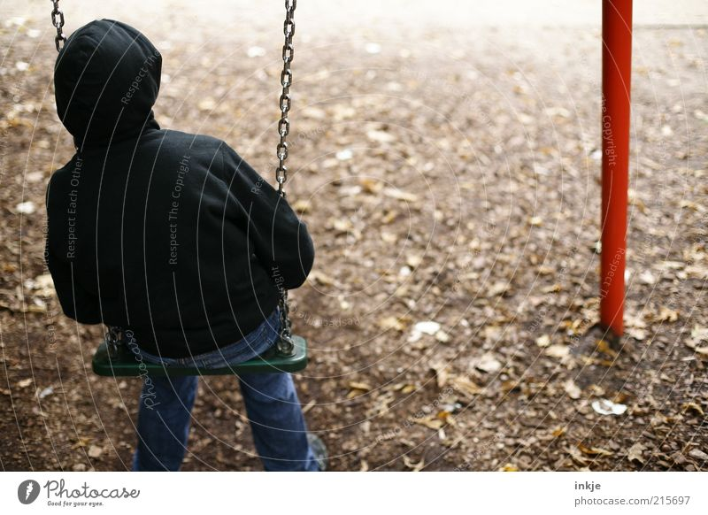 no one to play with... Playing Children's game Swing Playground Earth Autumn Park Jeans Hooded sweater Observe Think To swing Looking Sit Dream Sadness Wait
