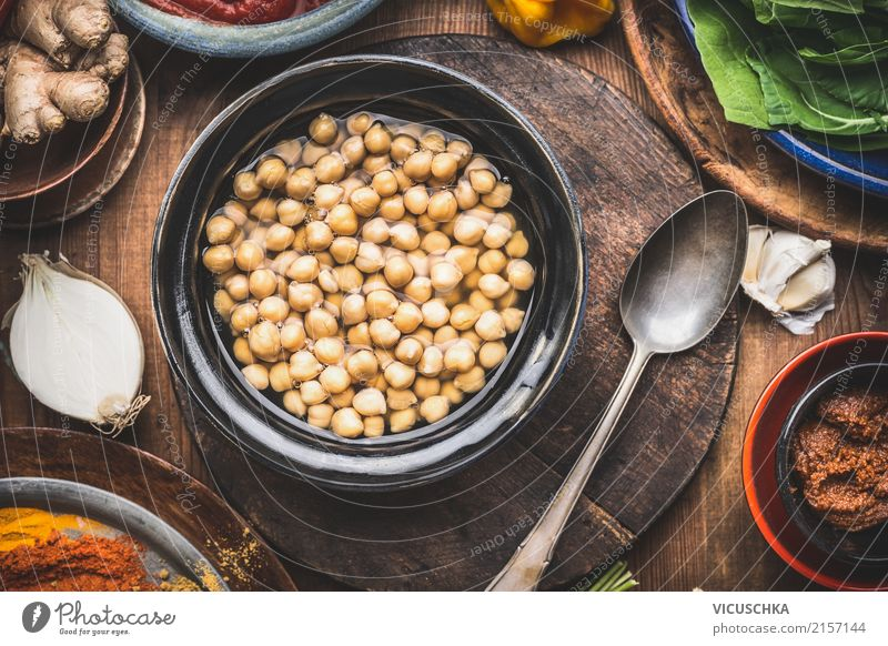 Cooked chickpeas in peel with spoon and cooking ingredients Food Grain Herbs and spices Cooking oil Nutrition Lunch Dinner Organic produce Vegetarian diet Diet