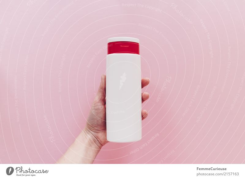 Plastic (03) Environment Personal hygiene PE bottle Containers and vessels Cosmetics Shampoo Hand Fingers Pink Retentive Packaging Colour photo Interior shot
