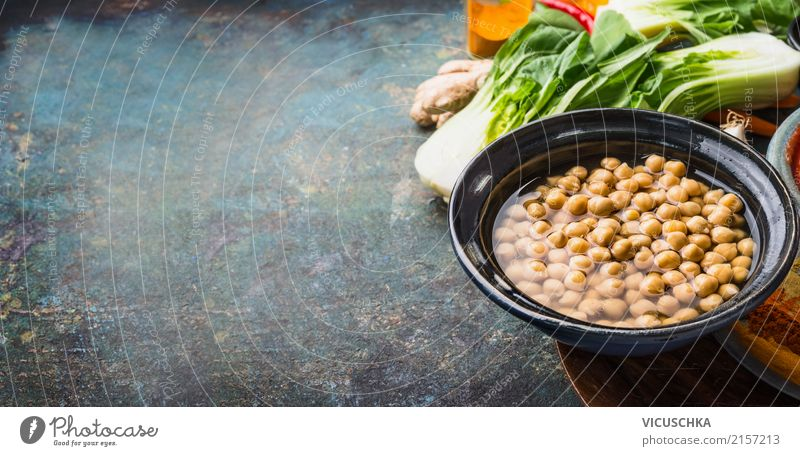 Chick peas in bowl with vegetarian cooking ingredients Food Vegetable Grain Herbs and spices Nutrition Organic produce Vegetarian diet Diet Crockery Bowl Style