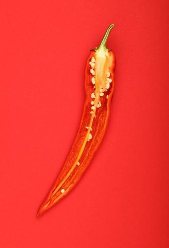 Half of hot chili pepper over red paper background Food Vegetable Nutrition Organic produce Vegetarian diet Diet Healthy Eating Aggression Hot Delicious Natural