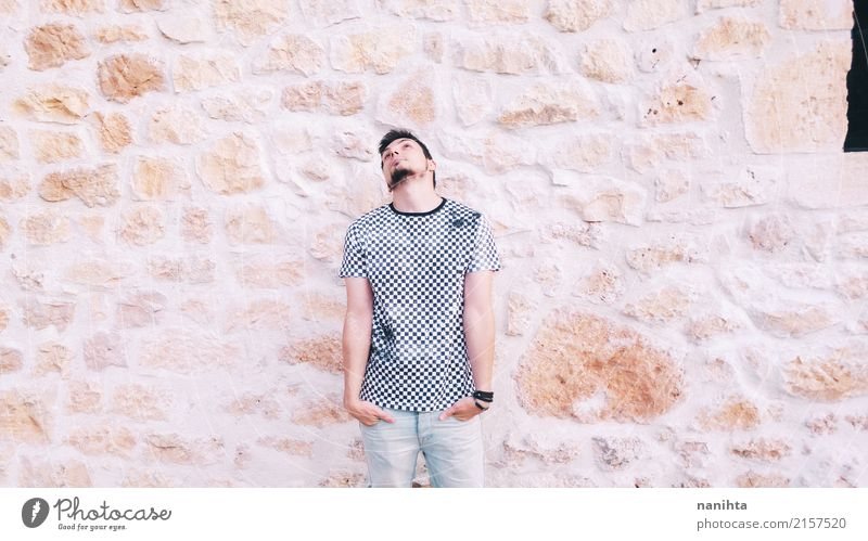 Young man posing with a stone wall as background Lifestyle Style Human being Masculine Youth (Young adults) 1 18 - 30 years Adults Youth culture Clothing