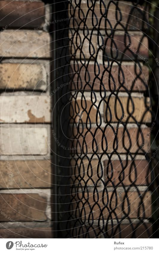 Fastening wall Wall (barrier) Wall (building) Fence Fence post Stone Metal Threat Dark Firm Thorny Gloomy Brown Yellow Black Safety Protection Animosity
