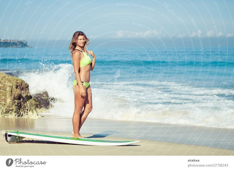 Beautiful Surfer Girl standing on the Beach Human being Woman Vacation & Travel Blue Summer Sun Ocean Eroticism Relaxation Joy Adults Lifestyle Coast Sports
