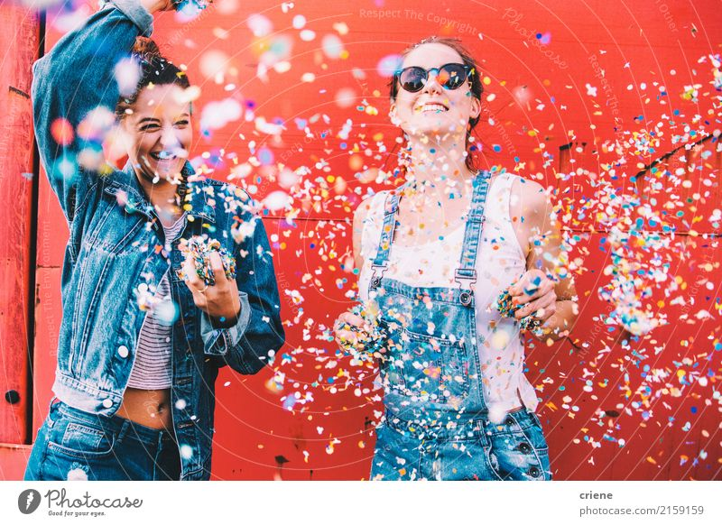 Two happy young adult friends dancing and throwing confetti Human being Youth (Young adults) Young woman Beautiful Joy 18 - 30 years Adults Lifestyle Emotions