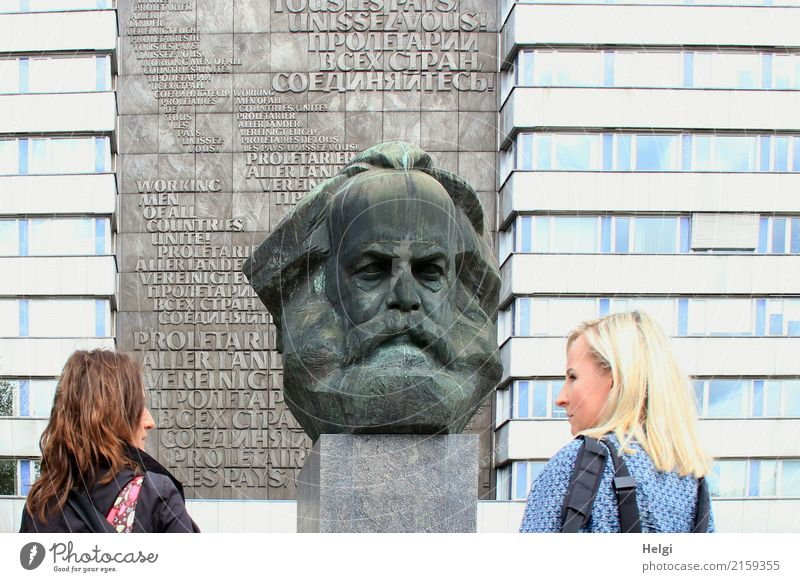 two women, one brunette, the other blond, stand in half profile in front of the Karl Marx monument in Chemnitz Human being Feminine Woman Adults 2 30 - 45 years