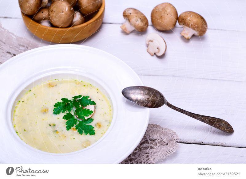 Cream mushroom soup of fresh champignons Vegetable Fruit Soup Stew Dinner Vegetarian diet Diet Plate Spoon Wood Fat Fresh Hot Above Brown White Slice Vegan diet