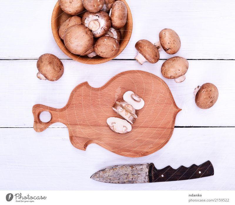 Fresh mushrooms champignons Food Vegetable Vegetarian diet Bowl Knives Kitchen Wood Brown White Champignon Mushroom board knife Top background Edible Raw whole