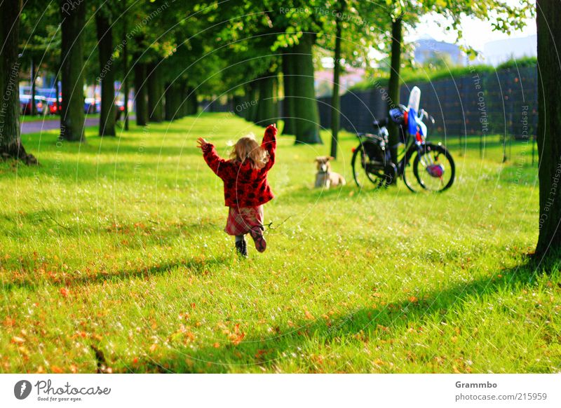 Human being Child Dog Green Tree Red Girl Joy Animal Grass Happy Friendship Park Bicycle Walking Trip