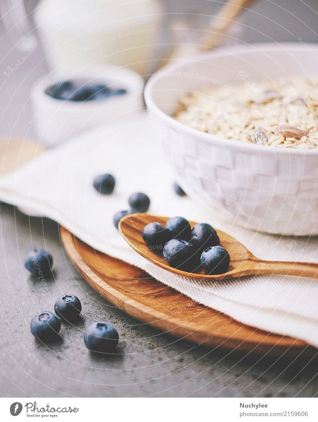 organic fresh blueberry and cereal with milk Fruit Nutrition Breakfast Organic produce Diet Bowl Spoon Healthy Eating Paper Wood Fresh Delicious Natural White