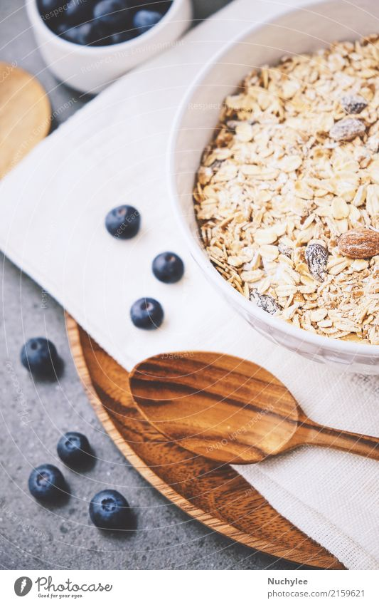 organic fresh blueberry and cereal Fruit Nutrition Breakfast Organic produce Diet Bowl Spoon Healthy Eating Paper Wood Fresh Delicious Natural White background