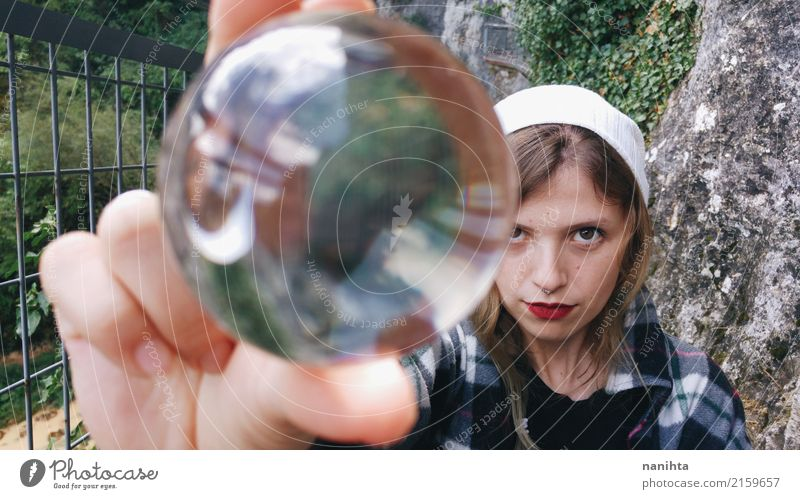 Young woman holding a crystal ball Human being Nature Youth (Young adults) Plant Far-off places 18 - 30 years Adults Feminine Earth Rock Blonde Glass Future