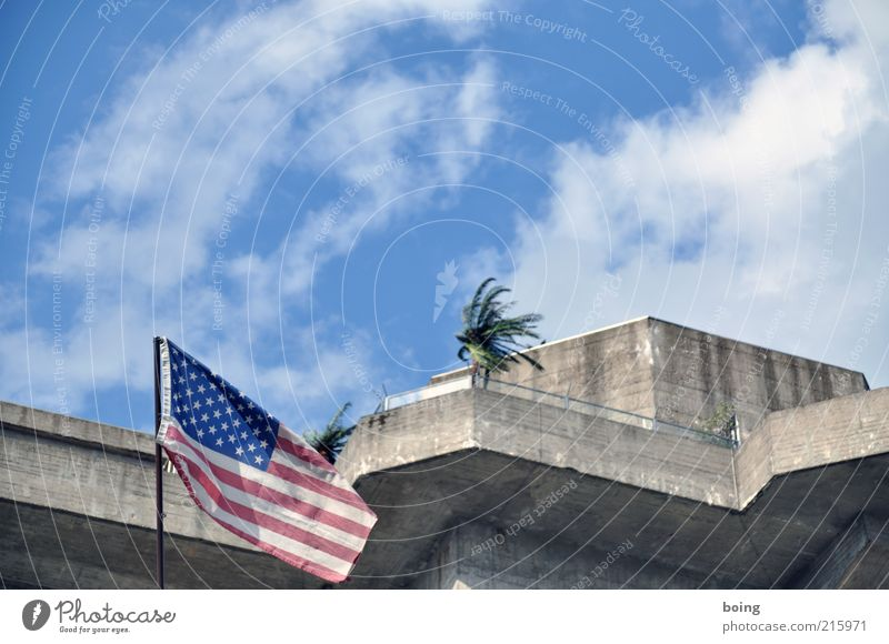 Clouds Building Wind Facade USA Flag Balcony Palm tree Landmark Beautiful weather American Flag Politics and state Blow Blue sky Military building