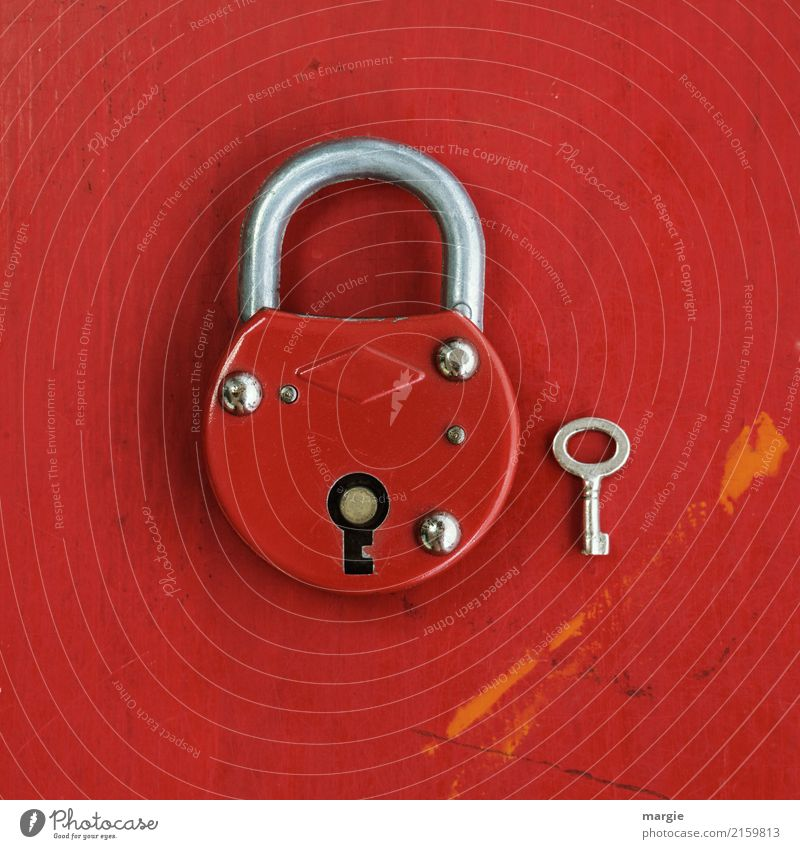 Big red lock with much too small key Living or residing Tool Technology Red Safety Key Padlock Door lock Size comparison Small Large Undo Close Security force