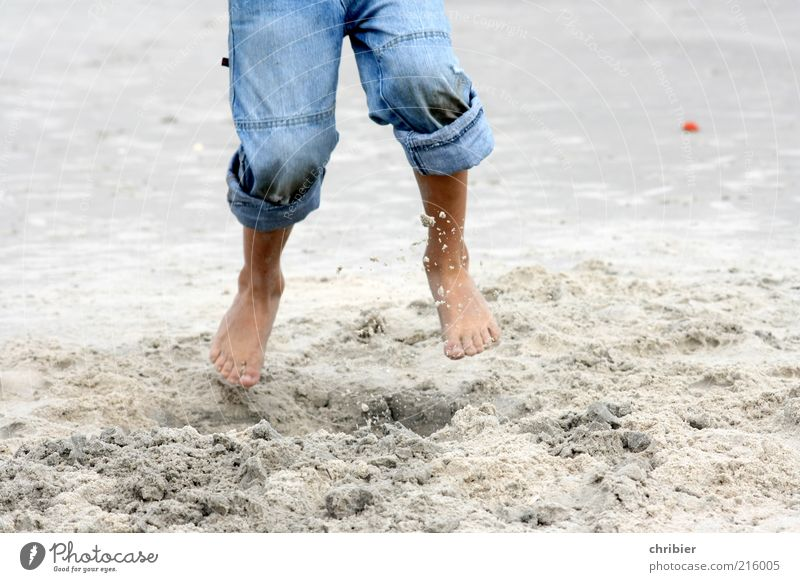 Holidays at last! Freedom Beach Child Legs Feet Barefoot 1 Human being Environment Sand Summer Coast knee sand Jeans Jump Romp Blue Joie de vivre (Vitality)