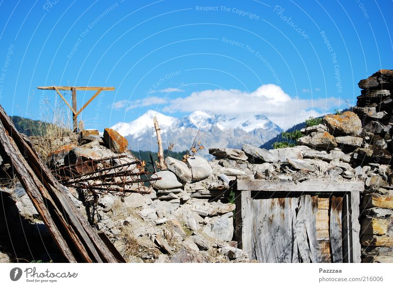Former room with view Far-off places Mountain Landscape Air Beautiful weather Caucasus Mountains Peak Snowcapped peak House (Residential Structure) Ruin