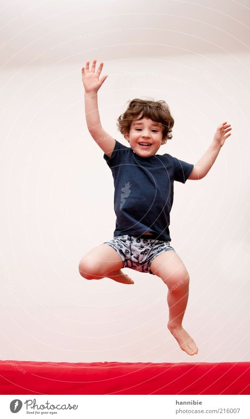 hop-jump Human being Masculine Child Boy (child) 1 3 - 8 years Infancy T-shirt Underwear Laughter Playing Jump Healthy Happiness Funny Blue Red White