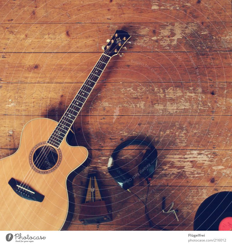 Old Lie Brown Music Leisure and hobbies Ground Listening Still Life Guitar Headphones Wooden floor Record Musical instrument Object photography Floor covering